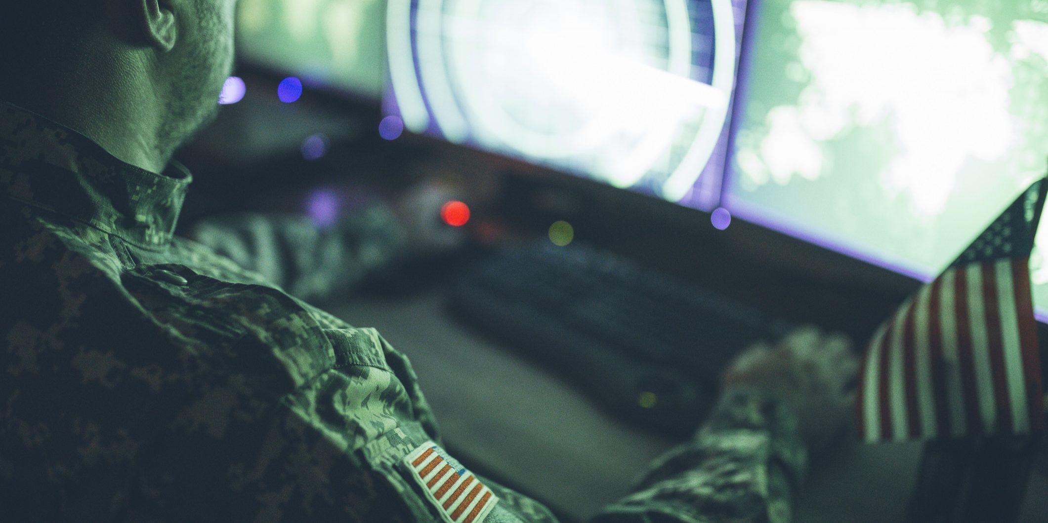 American soldier in headquarter control center