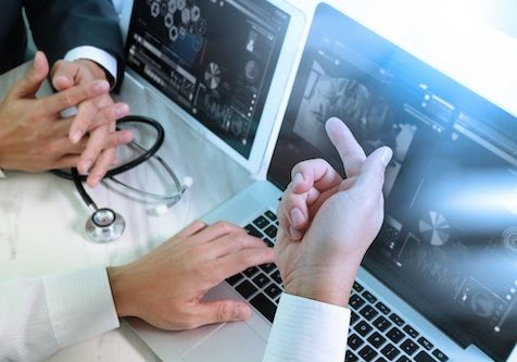 Medical technology network team meeting concept. Doctor hand working smart phone modern digital tablet laptop computer graphics chart interface, sun flare effect photo; Shutterstock ID 447839425; Purchase Order: -