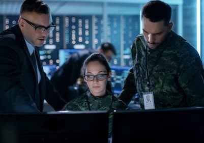 Government Surveillance Agency and Military Joint Operation. Male Agent, Female and Male Military Officers Working at System Control Center.; Shutterstock ID 669170761; Purchase Order: -